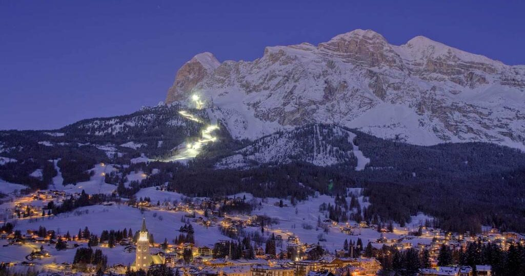The rich Cortina d'Ampezzo in winter with the ski slopes and the Dolomites in the background