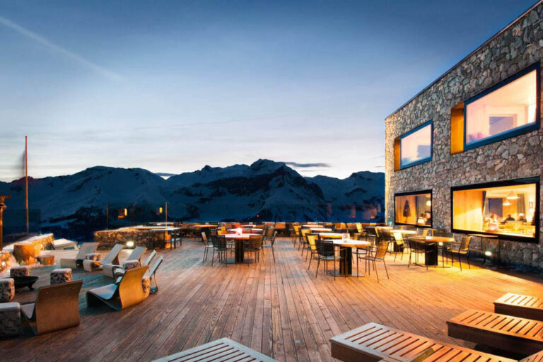Beautiful restaurant terrace of a Swiss Alps resort with a winter backdrop