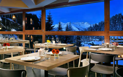 Resort dining room with white Alps in Aosta Valley. Italy