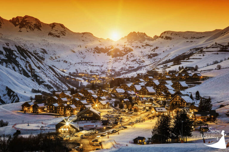Saint-Jean-d'Arves in France - Sunset on snowy French Alps. Winter mountains